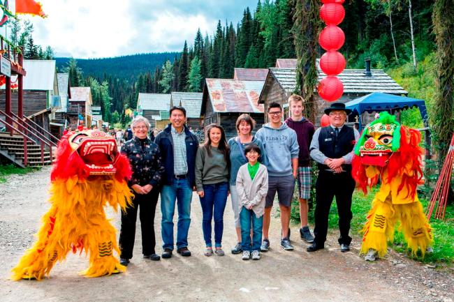 Barkerville CEO Judy Campbell with McElhanney's Bill Cheung and family, BHT Chair John Massier, and Lion Dancers
