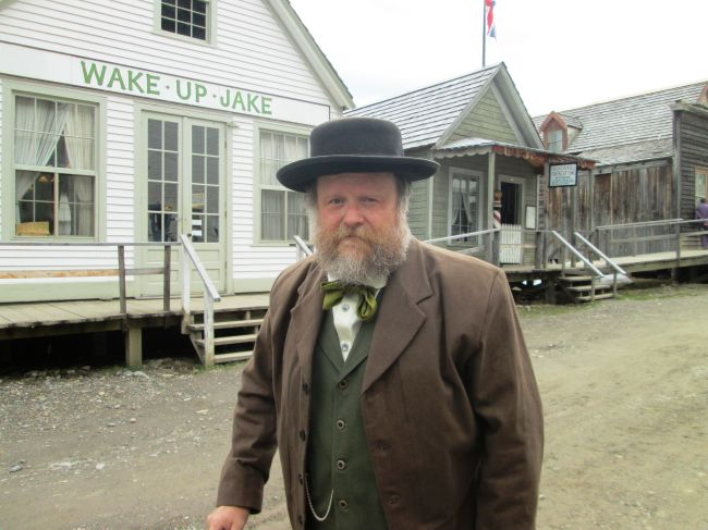 Billy Barker in Front of Wake Up Jake and Moses' Barber Shop (Close Up).