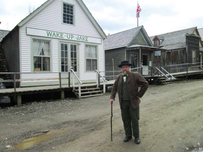 Billy Barker in Front of Wake Up Jake and Moses' Barber Shop (Full Body)