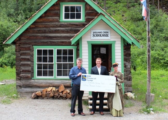 Barkerville CEO Ed Coleman, RBC Branch Manager Kevin Krampl and Williams Creek School Teacher Mrs. Bowron HORIZONTAL