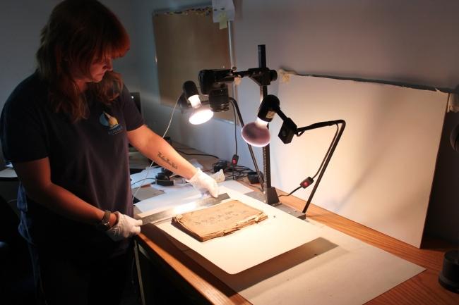Curatorial Assistant Erin de Zwart digitizing Chinese document